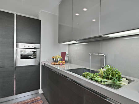 vetables near to sink in a modern kitchen Stock Photo