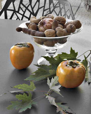 khaki and walnuts on the iron table on terrace Stock Photo - 16523205
