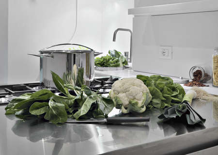 interior desing: vegetables on the steel worktop in a modern kitchen Stock Photo