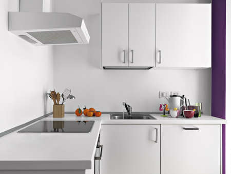 interiors: objects on the white worktop in a modern white kitchen
