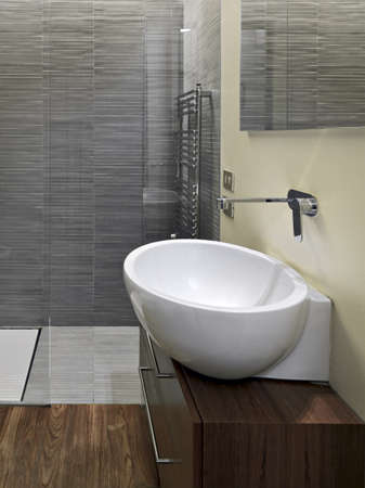 washbasin: detail of washbasin in the modern bathroom and wood floor Stock Photo