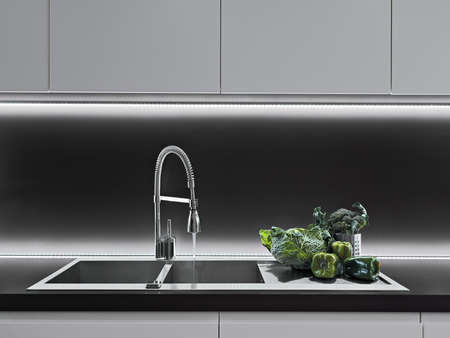 kitchen cabinet: vegetables on the worktop in a modern kitchen