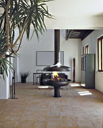 modern iron fireplace in living room Stock Photo