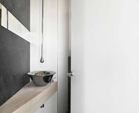 steel washbasin on the wood worktop in the modern bahtroom Stock Photo - 24098205