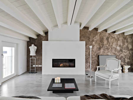 modern living room with fireplace and sofa in the attic