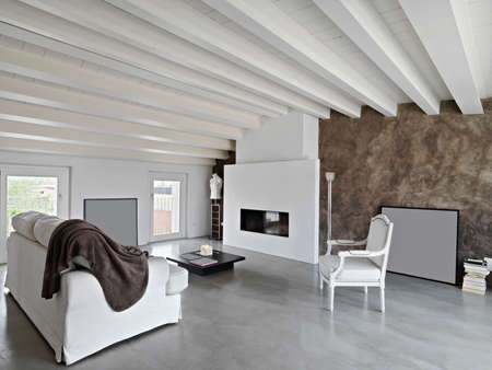modern living room with fireplace and sofa in the attic photo