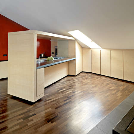 modern wood furniture in a modern kitchen in the attic photo