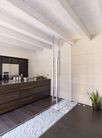 wood ceiling: modern kitchen with wood floor and wood ceiling and glass door