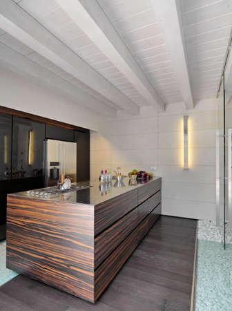 wood ceiling: modern kitchen with wood floor and wood ceiling Stock Photo