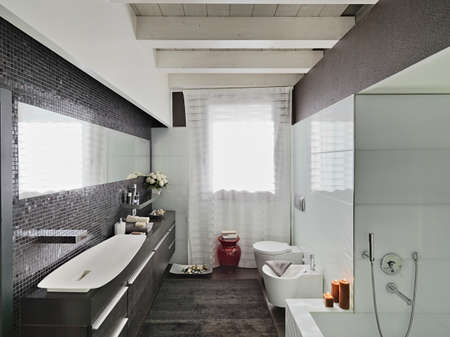 shower cubicle: modern bathroom in the mansard with wood floor Stock Photo