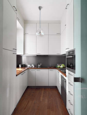cardunculus scolymus: modern white kitchen with wood floor