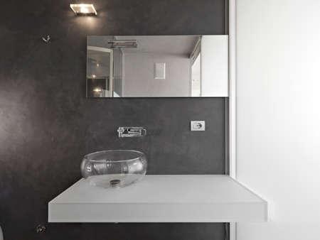 washbasin: detail of glass wasbasin in the modern bathroom