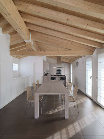 wood dining table in the modern dining room with wood ceiling Standard-Bild