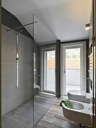 glass shower cubicle in a modern bahtroom and sanitary ware photo