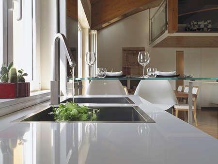 detail of steel sink in a modern kitchen in the mansard