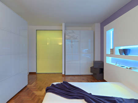 glass partition: interior view of a modern bedroom with glass wardrobe and wood floor Stock Photo