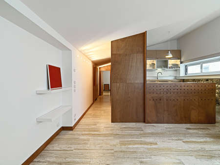 interior view of apartment with wood kitchen and marble floor photo