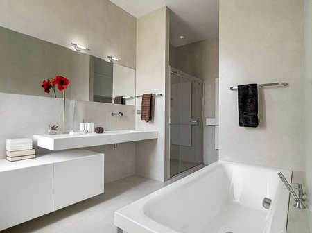 bathroom interior: panoramic view of a modern bathroom with washbasin and bathtub