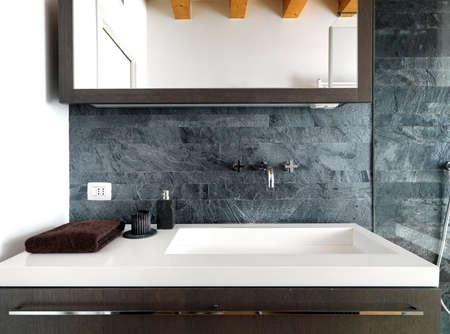washbasin: detail of modern washbasin in modern bathroom