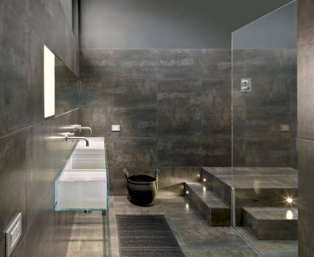 detail of a glass washbasin in a modern bathroom Editorial