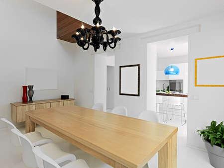 vista interno della moderna sala da pranzo che si affaccia sulla cucina