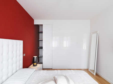 wood floor: Luxury modern bedroom with a red wall and wood floor