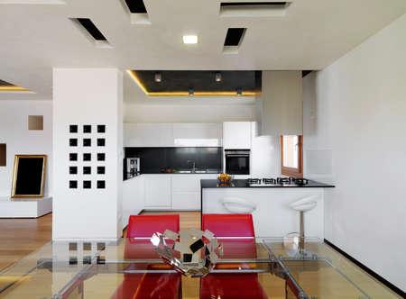 white wood floor: modern luxury white kitchen with wood floor