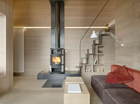 interior view of living room wirh staricase ,wood paneling and fireplace in rustic house