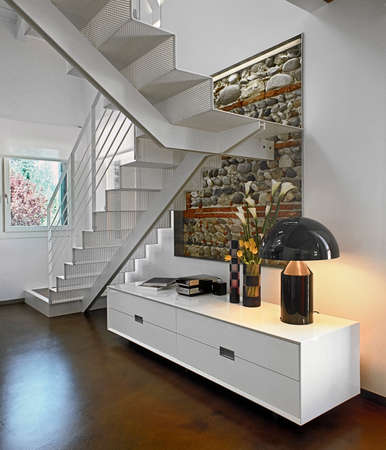 rockwall: white furniture and staircase in teh modern living room