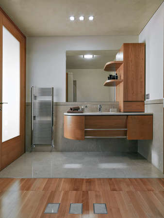 tile flooring: interior view of a modern bathroom in foreground wood funiture for washbasin
