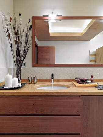washbasin: interior view of modern bathroom in the foreground washbasin