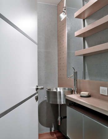 washbasin: interior view of a modern bathroom in foreground the washbasin