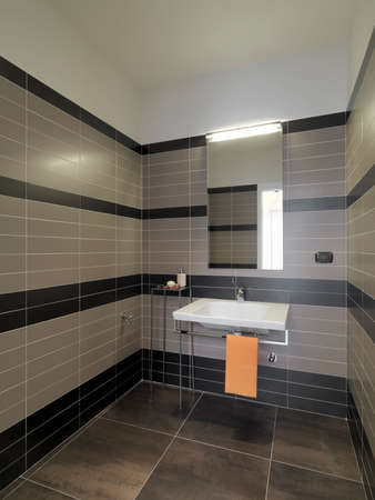 washbasin: interior view of a modern bahtroom in foreground the washbasin Stock Photo