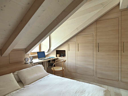 bedroom: interior view of a rustic bedroom in the attic room with wooden paneling Stock Photo