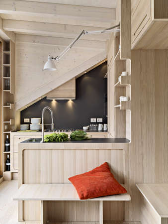 foreground on wooden modern kitchen island in the attic room