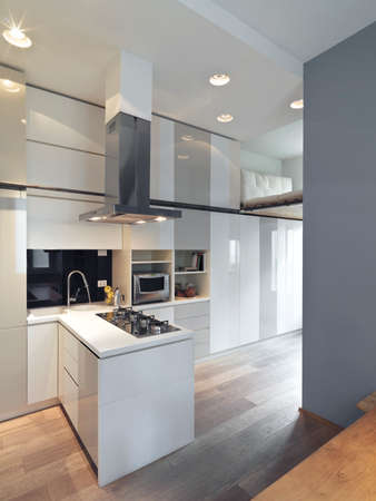 kitchen cabinet: interior view of a modern kitchen and kitchen island with wood floor Stock Photo