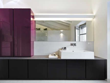 interior view of modern bathroom in foreground the washbasin photo