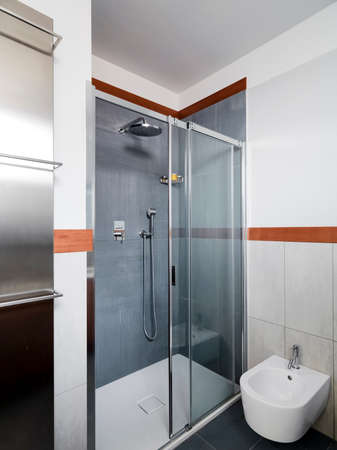 shower cubicle: interior view of a modern bathroom in foreground the shower cubicle Stock Photo