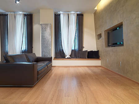 wood room: leather brown sofa in the modern living room  with wood floor and television