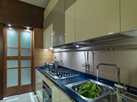 blue steel: modern kitchen with a blue top and steel tap open