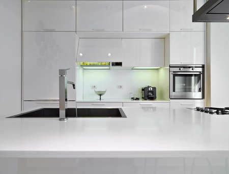 detail of a steel sfaucet in a modern kitchen
