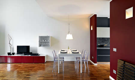 wood flooring: foreground of dining table near to living room and the kitchen with wood floor