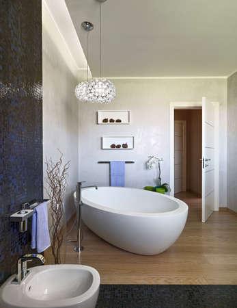 modern lamp: foeground of a bathtub in the modern bathroom wgich foor is made of wood