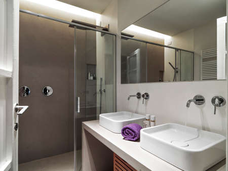 shower cubicle: foreground of two washbasin in the modern bathroom overlooking on the shower cubicle