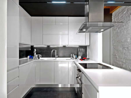 contemporary interior: foreground of a white modern kitchen Stock Photo