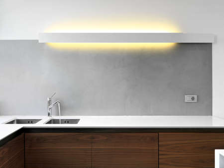 inerior view of a modern kitchen foreground on the sink