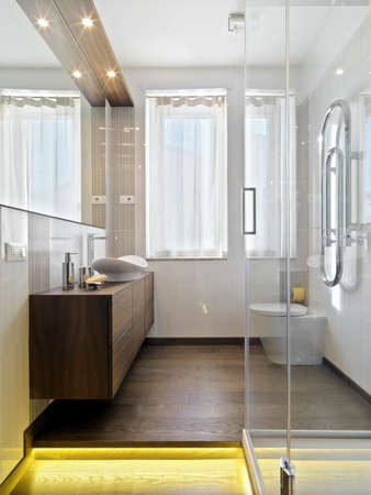 luxury apartment: interior view of a modern bathroom with wood floor Stock Photo