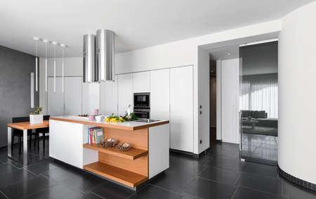 island: interior view of a modern kitchen with kitchen islad