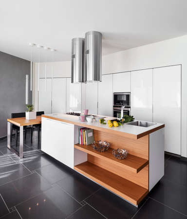 kitchen island: interior view of a modern kitchen island with dining table