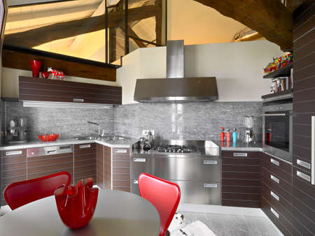 attic: interior view of a modern kitchen in the attic room with trusses Stock Photo